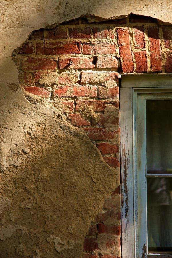 Stucco au-dessus de la construction historique photographie stock libre de droits