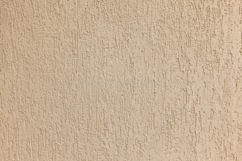 Stucco background. Pink rough stucco finishing texture royalty free stock photo