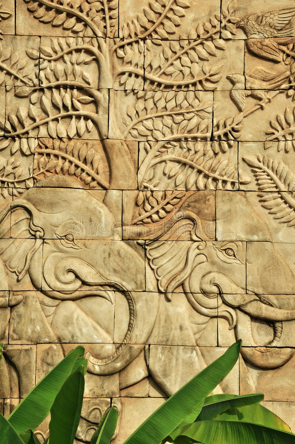 Download Stucco Carved Wall Depicting Elephants Stock Image - Image: 25797041
