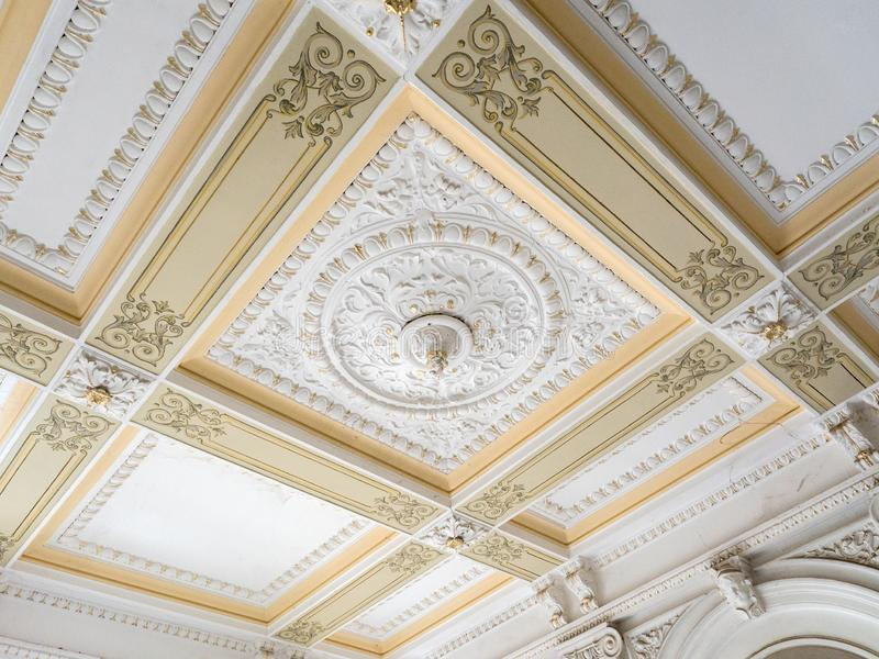 Stucco ceiling and wall. Molding, cornice. Old plaster architectural elements of the interior royalty free stock images