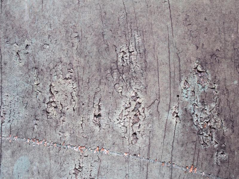 Stucco effect grey plastered cracked textured concrete surface. A stucco effect grey plastered cracked textured concrete surface stock photography