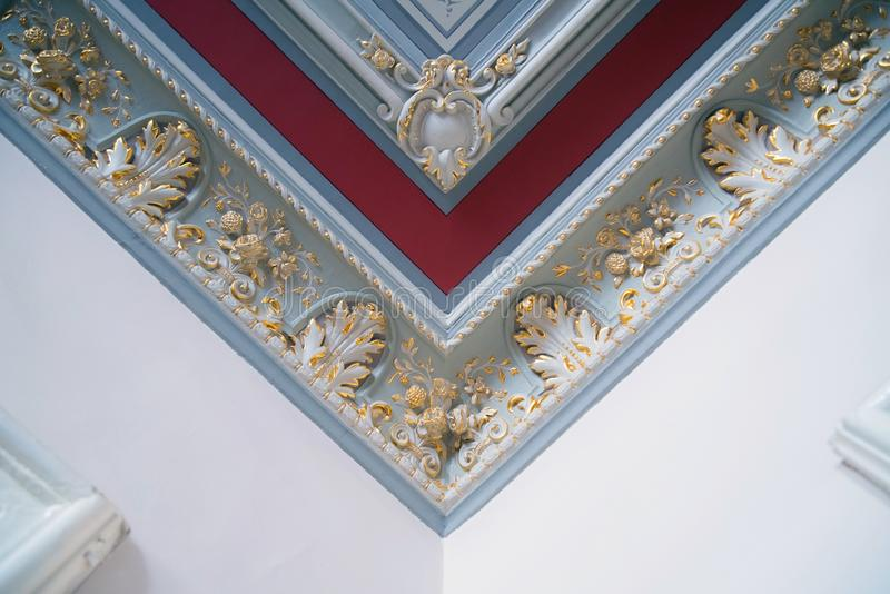 Stucco and luxurious decorative elements on ceiling. Luxury aesthetic in a modern home decor royalty free stock images