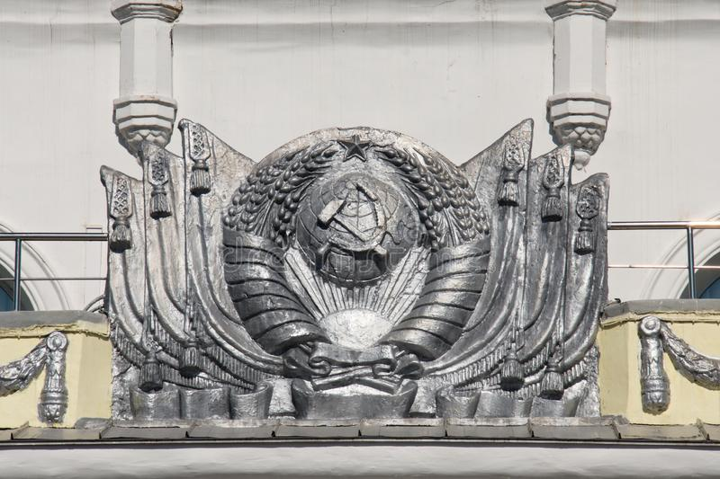 Stucco in the water of the coat of arms of the USSR on the building of Soviet architecture stock image