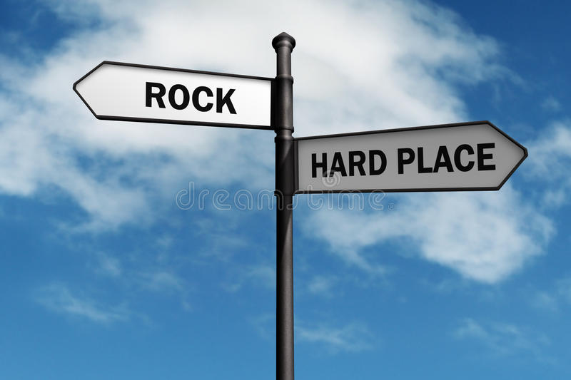 Stuck between a rock and a hard place stock photo