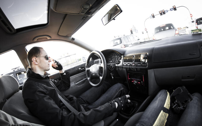 Stuck in traffic. Driver stuck in traffic, taken with fisheye lens royalty free stock images