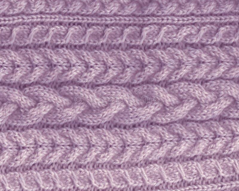 stucken backgroung purpurfärgad lavendeltextur stickmönster av ull kabelbeståndsdel royaltyfri fotografi