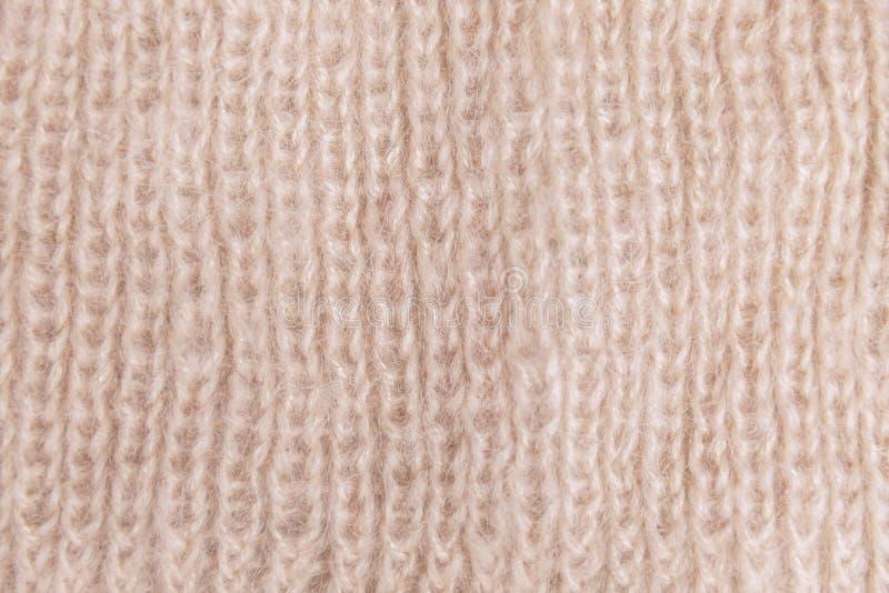 Stuckit ulltyg, modell, bakgrund som är handgjord royaltyfri bild