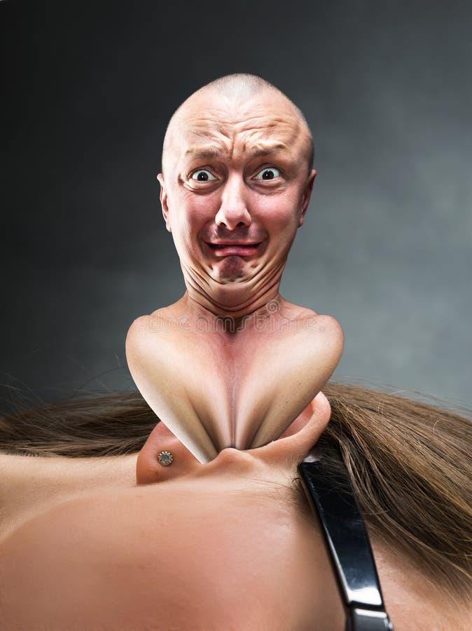 Stucks del hombre en un oído foto de archivo