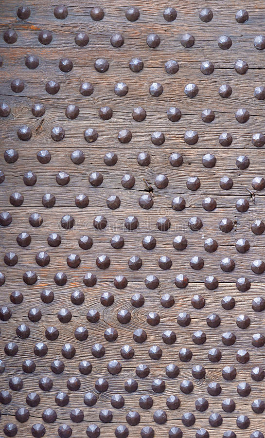 Studded, bolted, doornailed wood plank royalty free stock photos