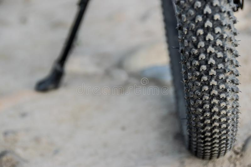 Studded tire of mountain bike, close-up. Diety mountain bike offroad tire. Close-up view of tire tread pattern stock photo