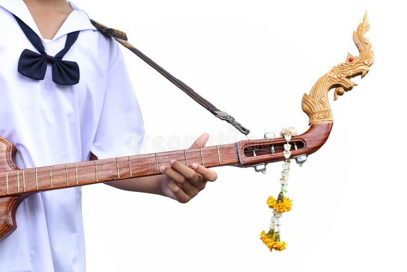 Studen artysta bawić się Phin nawleczonego oskubanego instrument zdjęcia stock