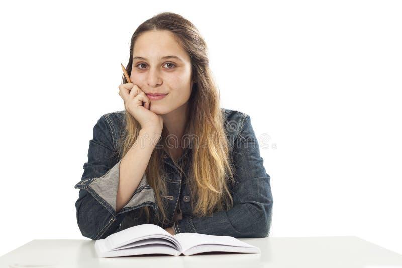 Studencka młoda dziewczyna z książką zdjęcie royalty free