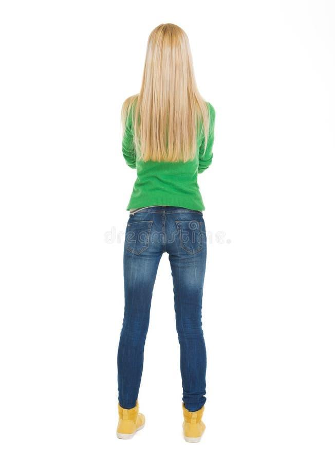 Studencka nastoletnia dziewczyna. Tylni widok fotografia stock