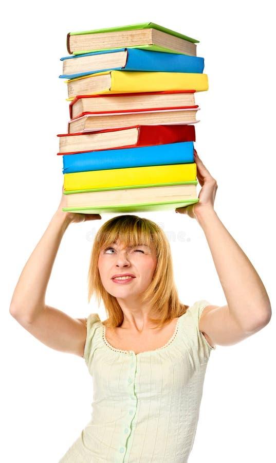 Studencki dziewczyny mienia sterty kolor rezerwuje nad głową. Odosobniony obraz stock