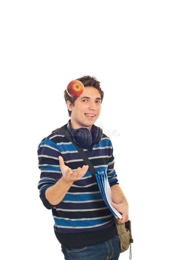 studencki jabłczany chłodno facet rzuca studencki zdjęcia stock