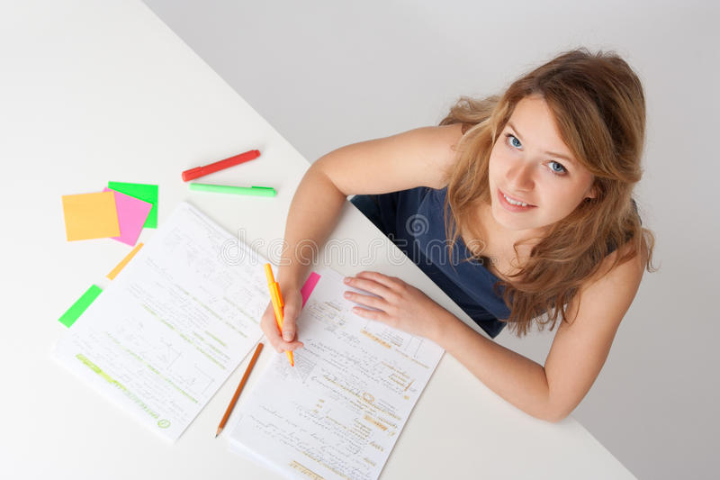 Student. College student studying (swot up) for exam. Focused on face. Top view stock photos