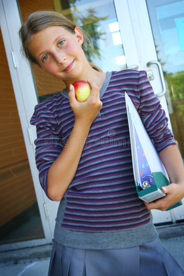 Student with apple royalty free stock photo