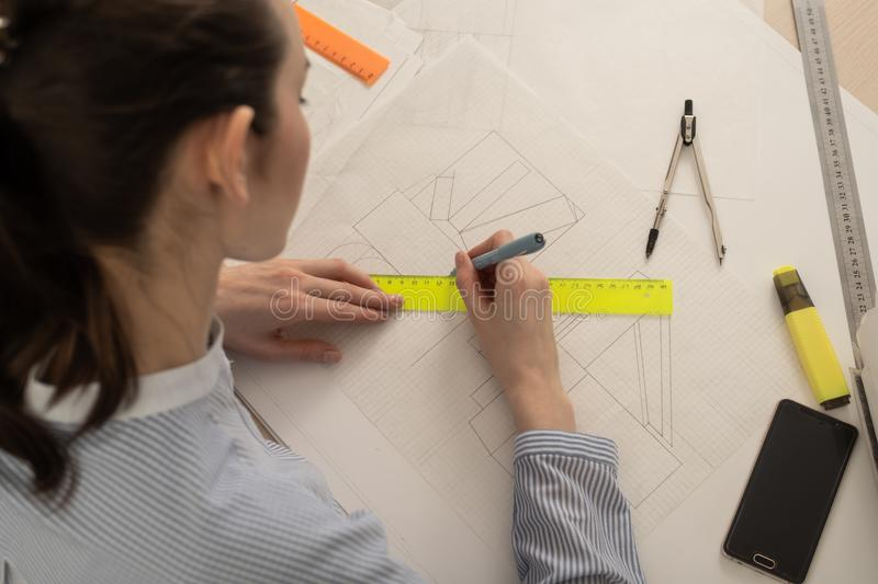 Student architect draws geometric shapes, design practice.  stock images
