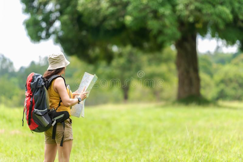 Student asian women and traveler with backpack adventure holding map to find directions location and leisure destination place in royalty free stock image