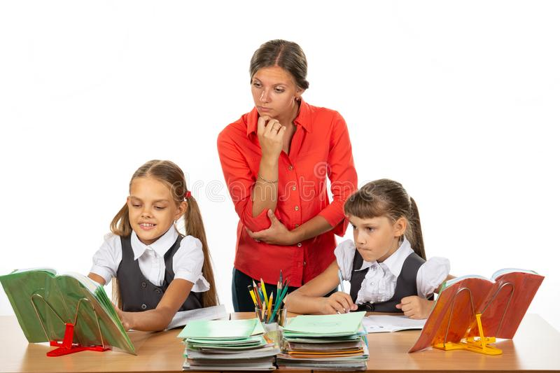 The student asked the teacher a question, the teacher looks at the book in disbelief stock image