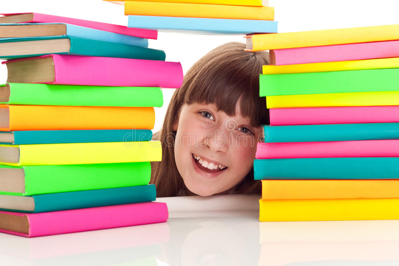Student behind pile of books stock images