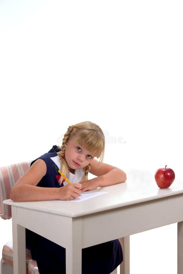 Student bij desk2 stock afbeeldingen