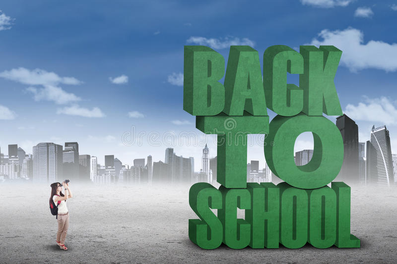 Student with binoculars looks at text of back to school. Female college student using binoculars to see a text of back to school, shot outdoors stock illustration