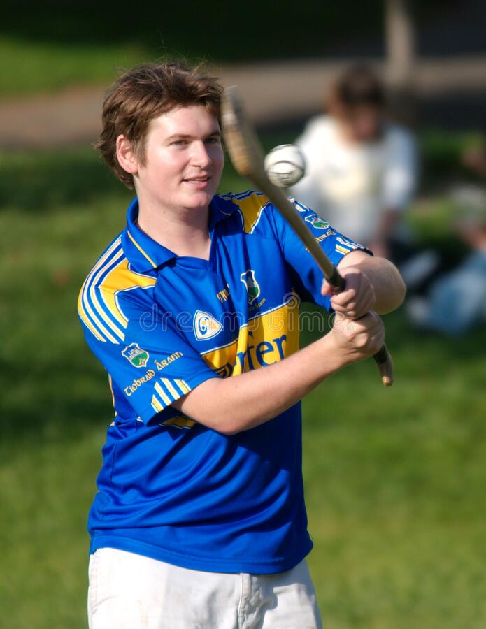 Student In Blue And Yellow Shirt Practicing Hurling Hitting Ball 2 Free Public Domain Cc0 Image