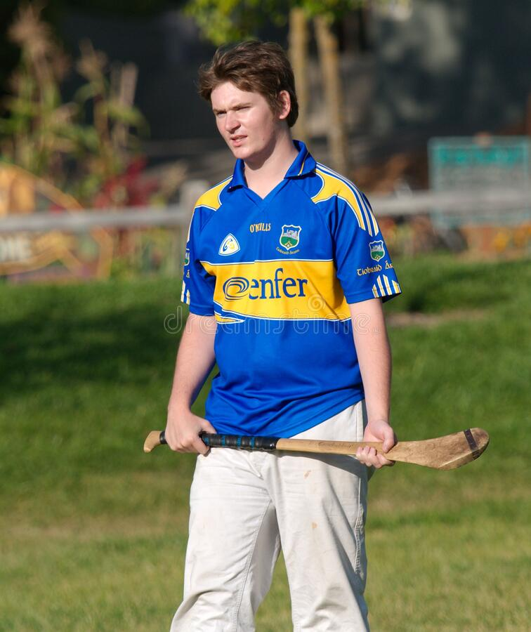 Student In Blue And Yellow Shirt Practicing Hurling - Standing Free Public Domain Cc0 Image