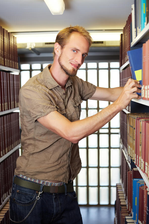 Student on book shelf stock images