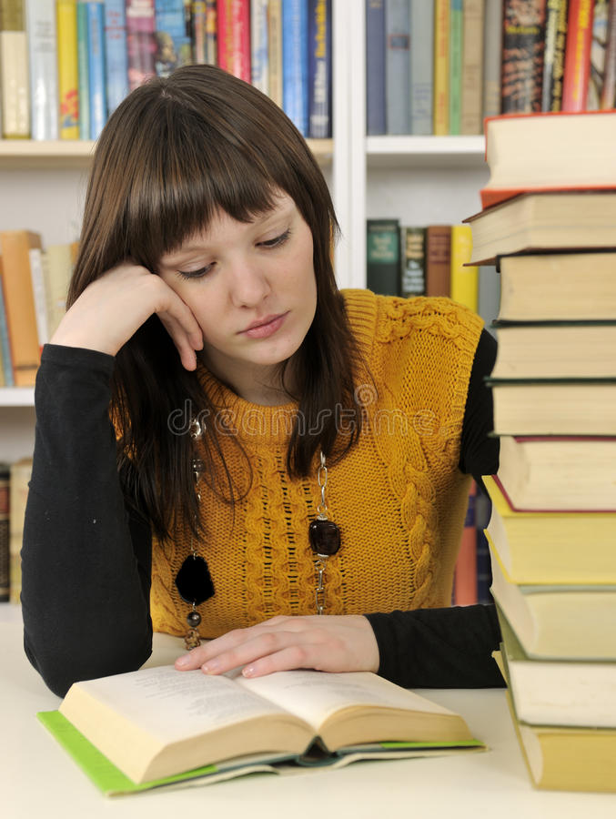 Student With Books In A Library Royalty Free Stock Images