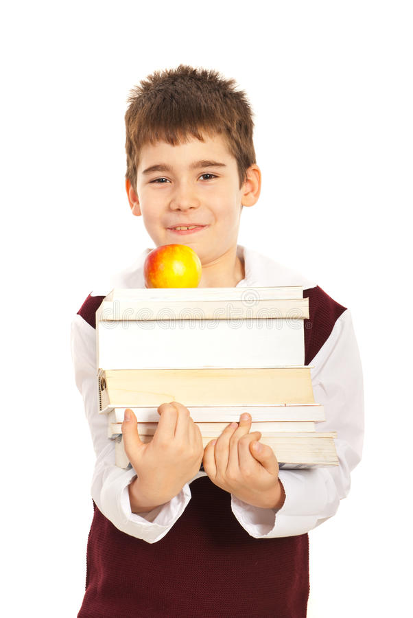 Student boy carrying books stock photos