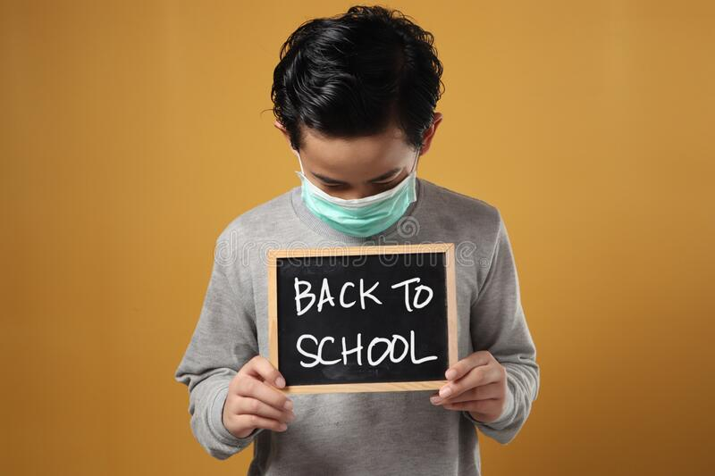 Student boy miss school during covid coronavirus pandemic lockdown qurantine, bored to stay at home too long stock images