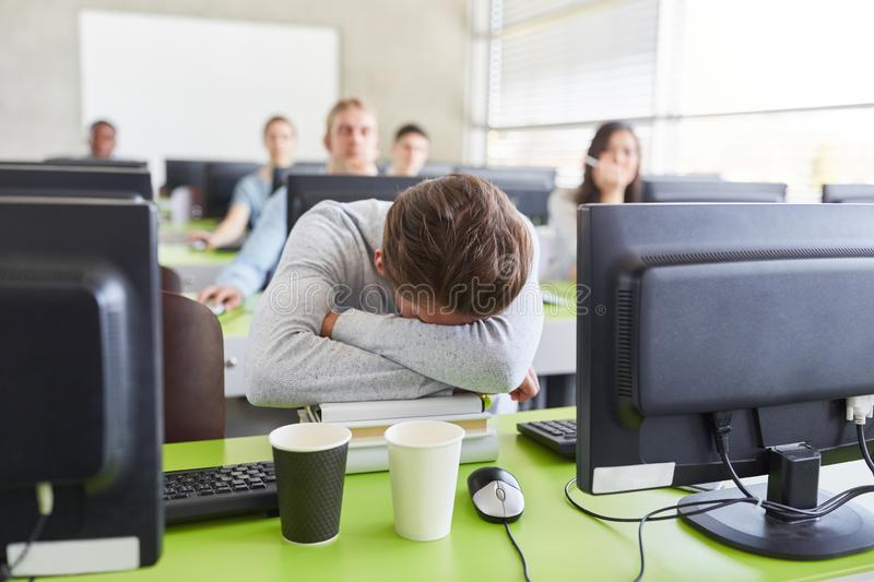 Student with Burnout and exhaustion. In computer course at university stock photography