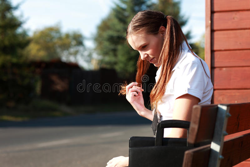 Download Student at bus stop stock photo. Image of cute, playing - 12661548