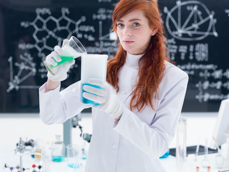 Download Student in chemistry lab stock photo. Image of green - 31257918