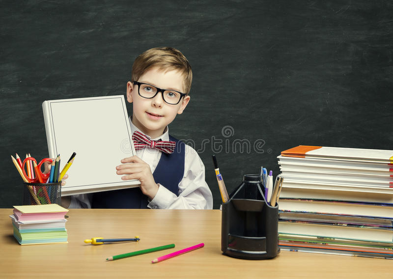 Student Child holding Book Cover, School Kid Boy in Classroom. Elementary Education royalty free stock photos