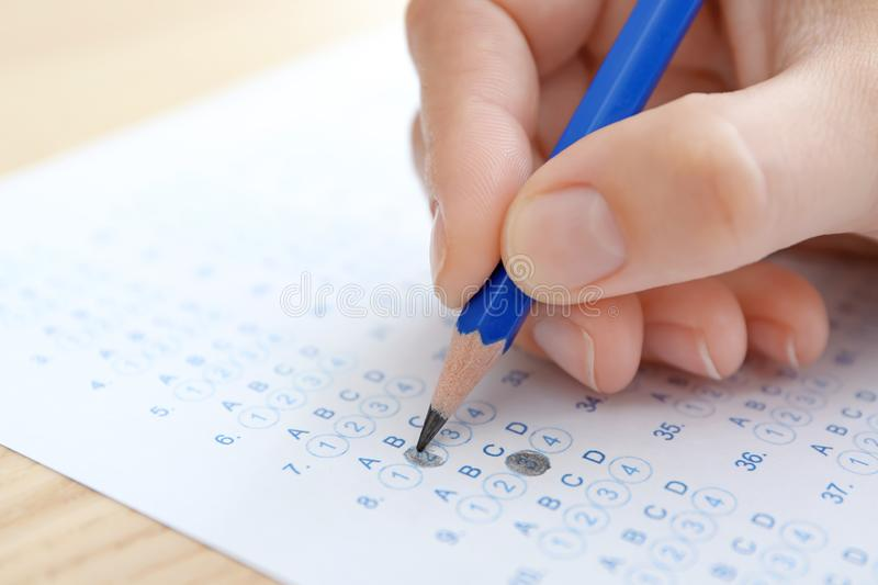 Student choosing answers in test form to pass exam royalty free stock photo