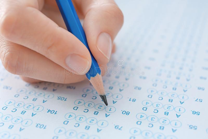 Student choosing answers in test form to pass exam royalty free stock photos