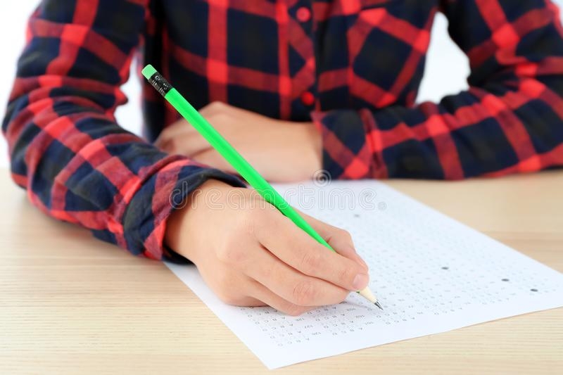 Student choosing answers in test form to pass exam stock image