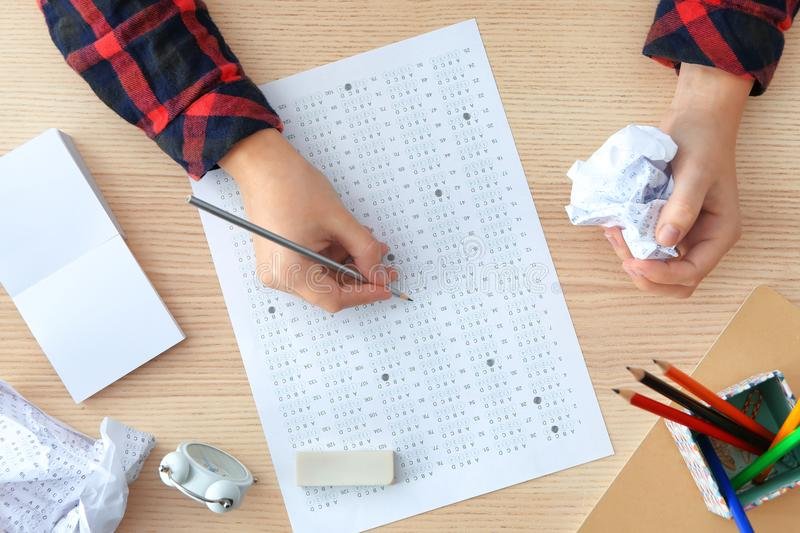 Student choosing answers in test form to pass exam royalty free stock images