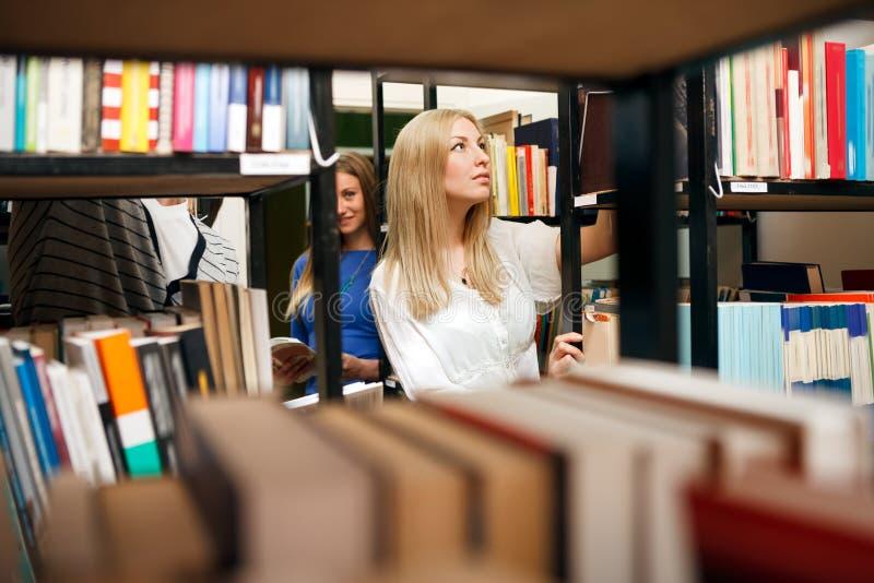 Student choosing books royalty free stock image