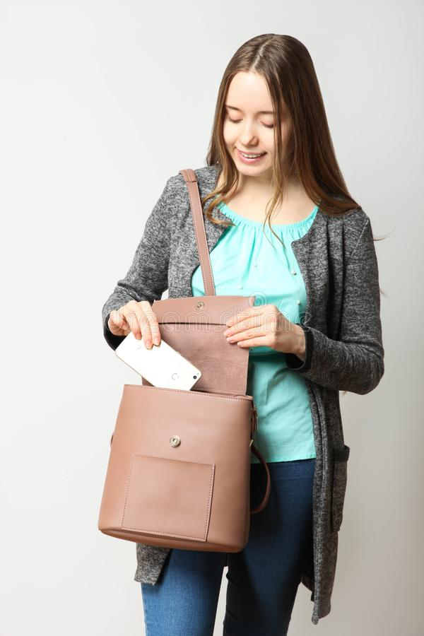 Student in classic casual comfortable clothes with fashionable backpack. Girl, student in classic casual comfortable clothes with fashionable backpack on neutral royalty free stock image