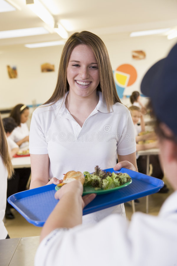 A student collecting lunch in school cafeteria royalty free stock images