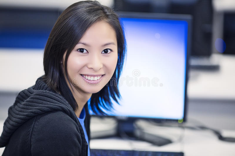 Student in Computer Lab. Portrait of beautiful Asian student in the computer lab