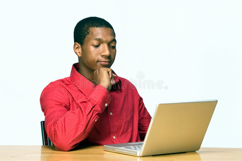 Student Concentrates on Laptop - Horizontal
