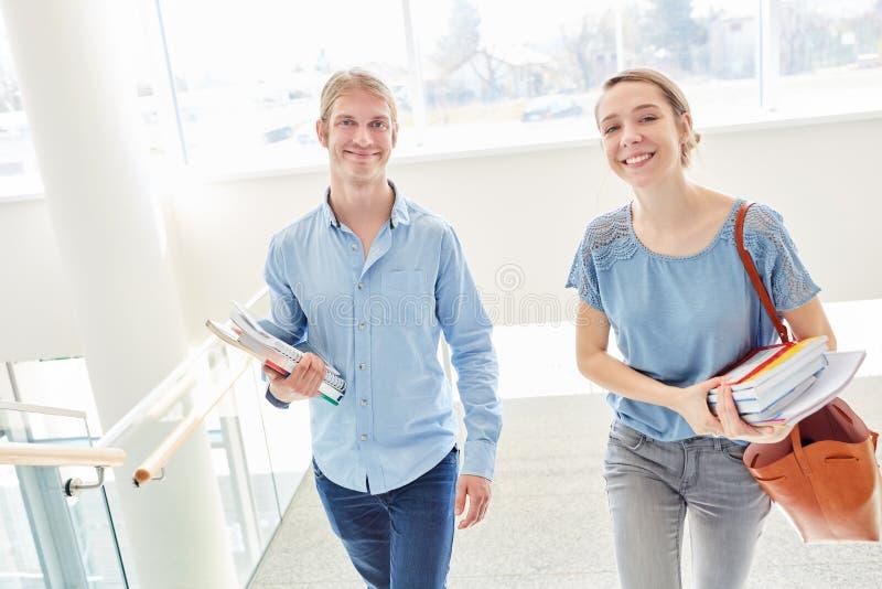 Students couple as freshmen. Student couple as freshmen holding books un university stock photo