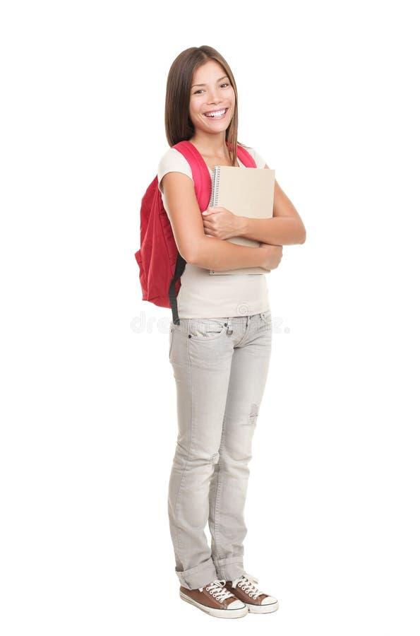 Student, der auf weißem Hintergrund steht stockfotografie