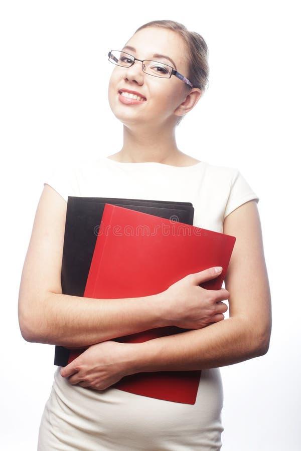 Student, der Kamera lächelt und betrachtet lizenzfreie stockfotografie