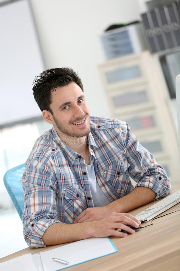 Student designer working at office. Student in web-design working in office royalty free stock images